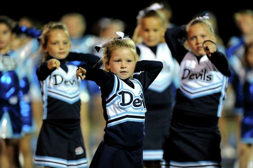 Samantha Nusbaum, 6, of East Greenbush, center, does a half-time routine with her cheer squad during
