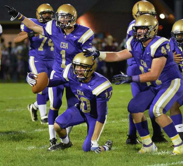 CBA's teammates react after #10 Drew Brundige's, with ball, interception against La Salle during the