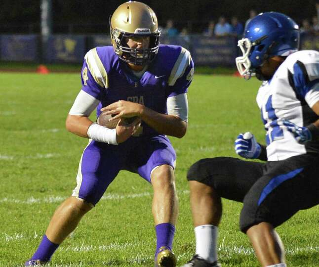 CBA quarterback Troy Anthony, left, scrambles in for a touch down against La Salle during the game k