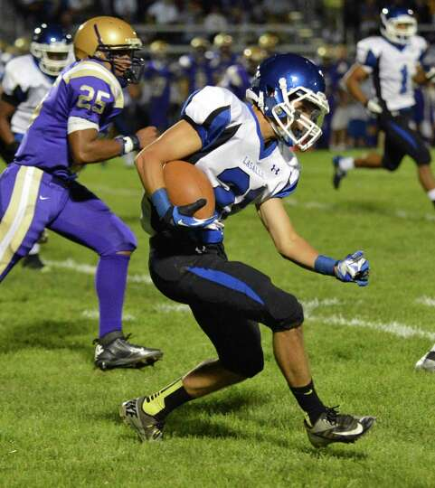 La Salle's #21Connor Luizzi gains ground against CBA's defense during the game known as the Battle f