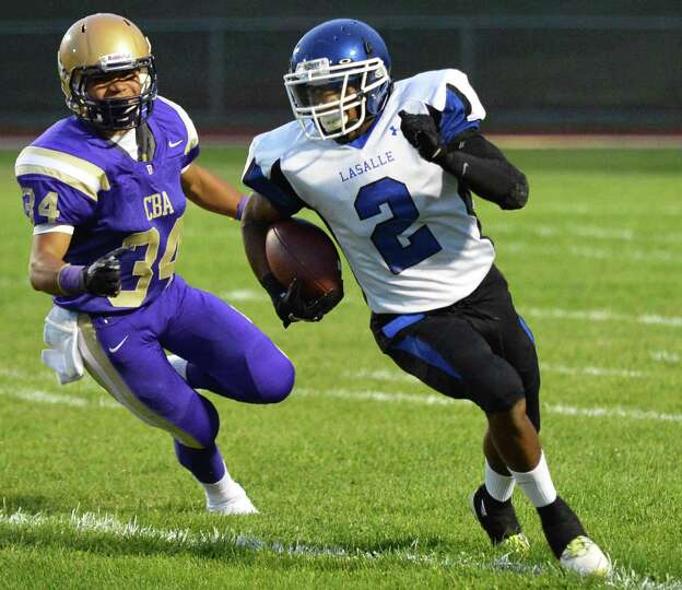 La Salle's #2 Gabriel Smith runs the ball against CBA during the game known as the Battle for the Sa