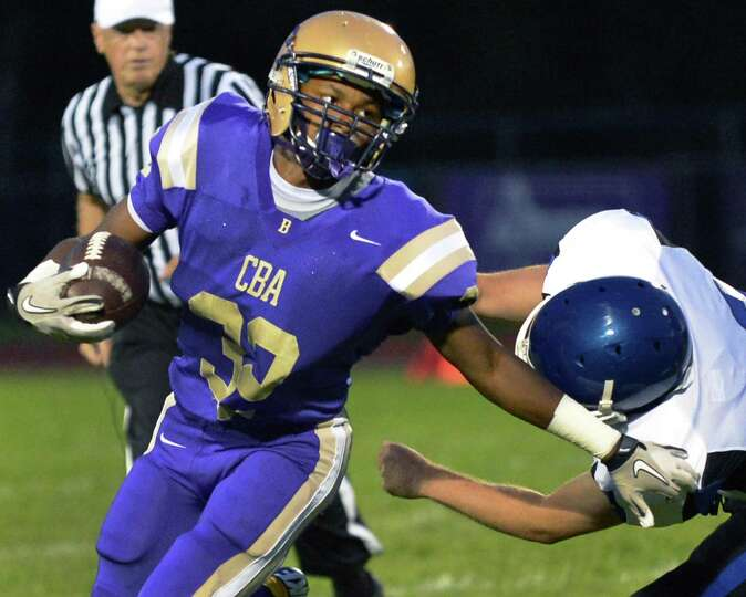CBA's #32 Spencer Hall, left, gets by a La Salle defender during the game known as the Battle for th