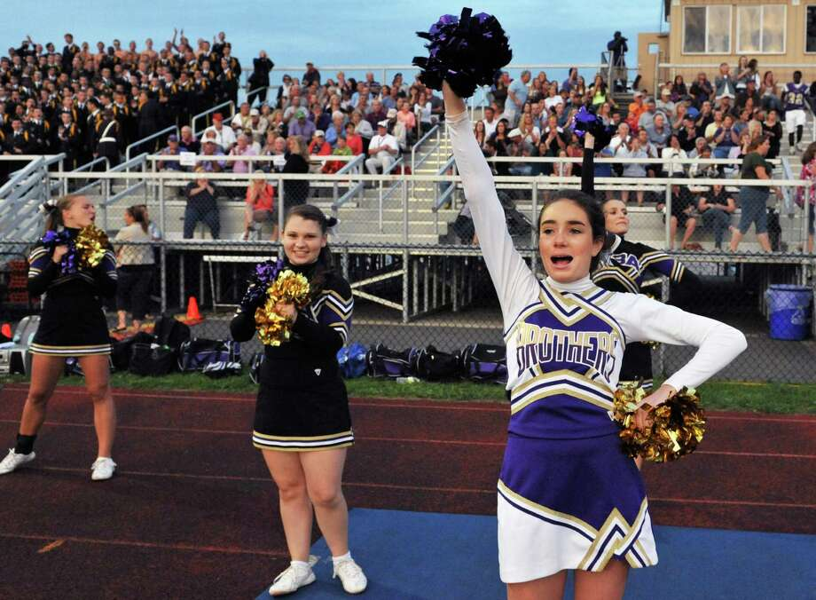 CBA Holy Names cheerleader Alivia O'Hagan, at right, during Friday night's game against La Salle at CBA in Colonie Sept. 14, 2012. (John Carl D'Annibale / Times Union) Photo: John Carl D'Annibale / 00019196A