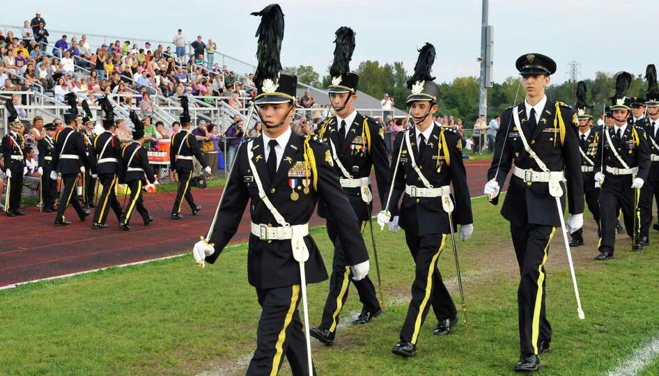 Cadet officers lead CBA freshmen, who pass in review during a ceremony before Friday night's game ag