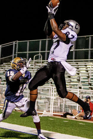 Clark's R'Mani Bettis (right) leaps high in the air to try to pull down a two-point conversion over O'Connor's Alan Wright during the second half of their game at Farris Stadium on Sept. 14, 2012. O'Connor won the game 52-19.  MARVIN PFEIFFER/ mpfeiffer@express-news.net Photo: MARVIN PFEIFFER, Express-News / Express-News 2012