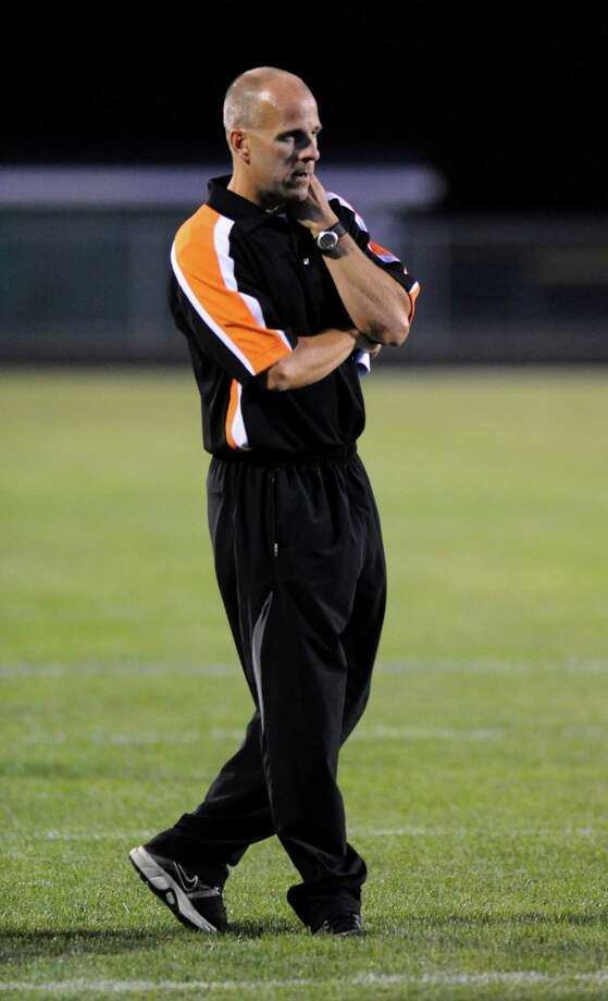 Schuylerville head coach Greg O'Connor coaches his team against  Schalmont during their football game in Rotterdam, N.Y., Friday, Sept. 14, 2012. (Hans Pennink / Special to the Times Union) High School Sports. Photo: Hans Pennink / Hans Pennink
