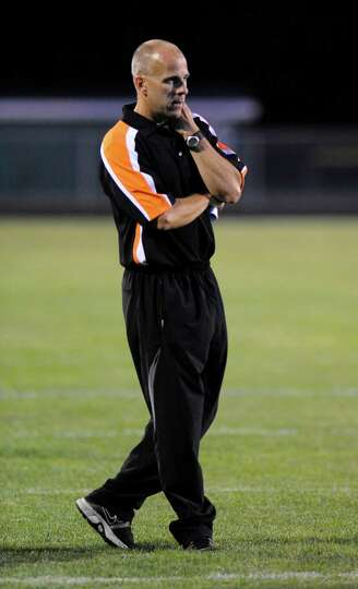 Schuylerville head coach Greg O'Connor coaches his team against  Schalmont during their football gam