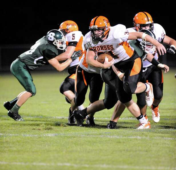 Schuylerville's Danny Waldren (31) runs the ball against Schalmont during their football game in Rot