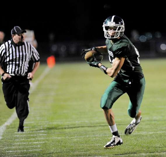 Schalmont's Dom Caputo (81) makes a catch and runs for a touchdown against Schuylerville during thei