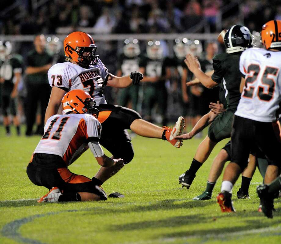 Schuylerville's Shane Lyon (11) holds as Larry Messer (73) kicks an extra point against Schalmont by during their football game in Rotterdam, N.Y., Friday, Sept. 14, 2012. (Hans Pennink / Special to the Times Union) High School Sports. Photo: Hans Pennink / Hans Pennink