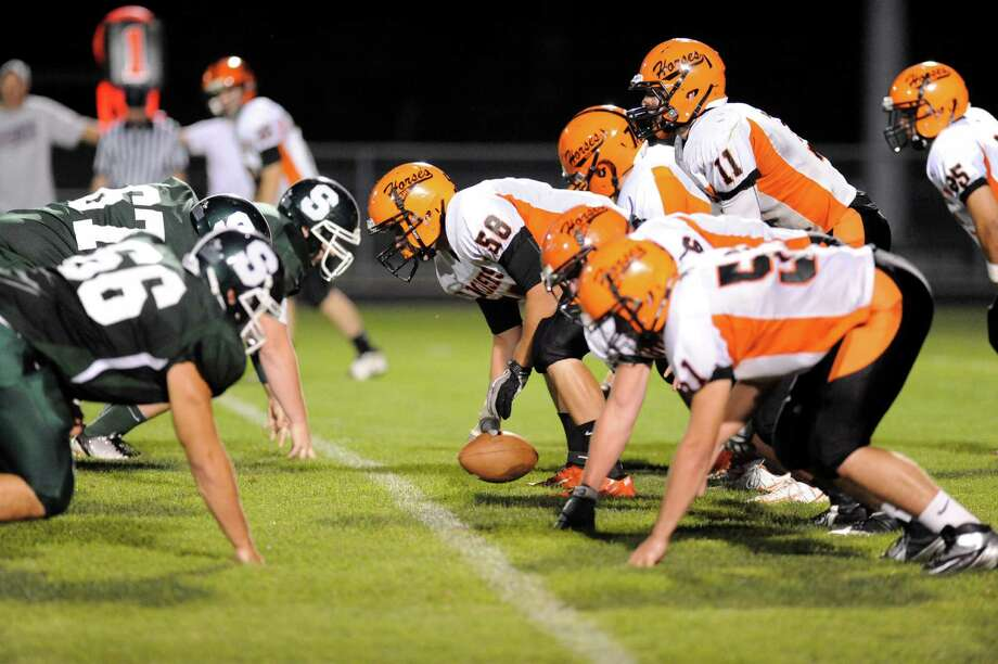 Schuylerville's center Cody Mason (58) is called for a false start against Schalmont during their football game in Rotterdam, N.Y., Friday, Sept. 14, 2012. (Hans Pennink / Special to the Times Union) High School Sports. Photo: Hans Pennink / Hans Pennink