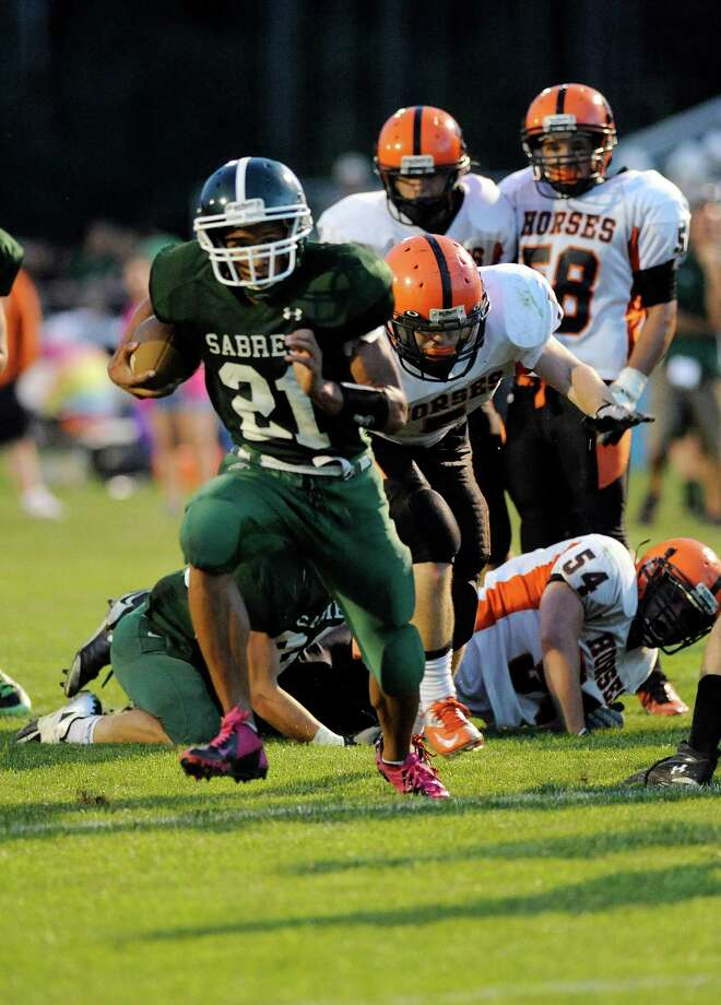 Schalmont's Devon Wilis (21) runs the ball against Schuylerville during their football game in Rotterdam, N.Y., Friday, Sept. 14, 2012. (Hans Pennink / Special to the Times Union) High School Sports. Photo: Hans Pennink / Hans Pennink