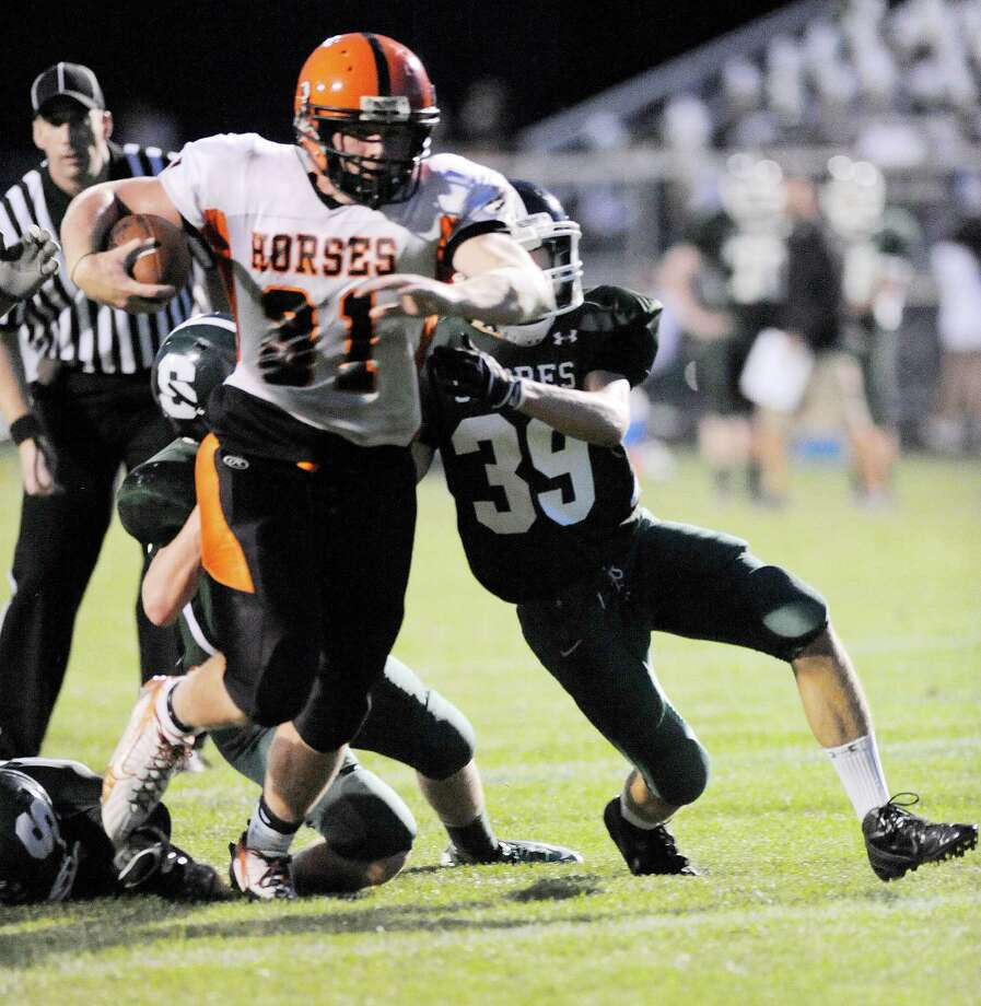 Schuylerville's Danny Waldron (31) runs for a touchdown against Schalmont during their football game in Rotterdam, N.Y., Friday, Sept. 14, 2012. (Hans Pennink / Special to the Times Union) High School Sports. Photo: Hans Pennink / Hans Pennink