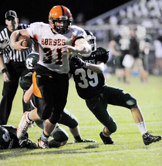 Schuylerville's Danny Waldron (31) runs for a touchdown against Schalmont during their football game