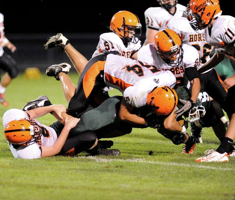 Schalmont's Kyle Strube (29) is taken down hard by Schuylerville during their football game in Rotterdam, N.Y., Friday, Sept. 14, 2012. (Hans Pennink / Special to the Times Union) High School Sports. Photo: Hans Pennink / Hans Pennink