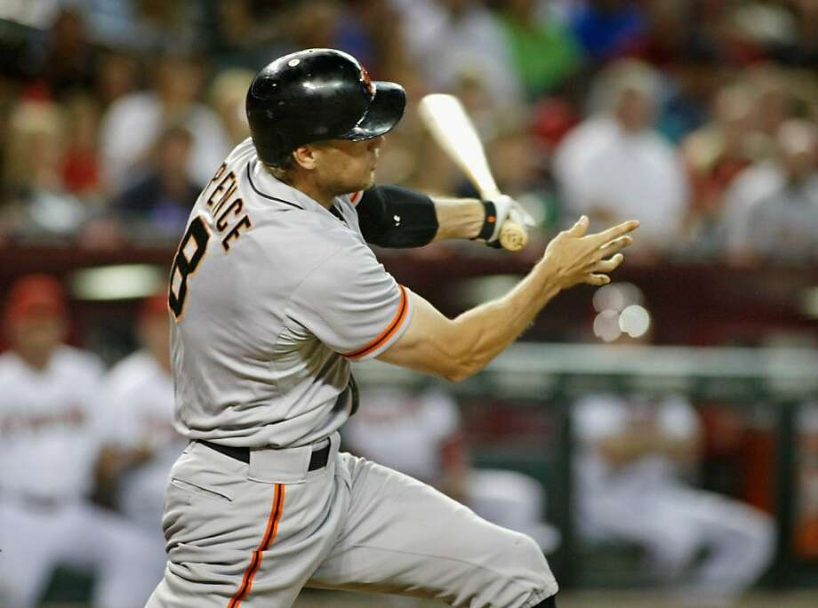 PHOENIX, AZ - SEPTEMBER 14: Hunter Pence #8 of the San Francisco Giants watches as he drives the ball over the left field fence for a grand slam home run off Tyler Skaggs #37 of the Arizona Diamondbacks during the third inning of a MLB game at Chase Field on September 14, 2012 in Phoenix, Arizona. (Photo by Ralph Freso/Getty Images) Photo: Ralph Freso, Getty Images
