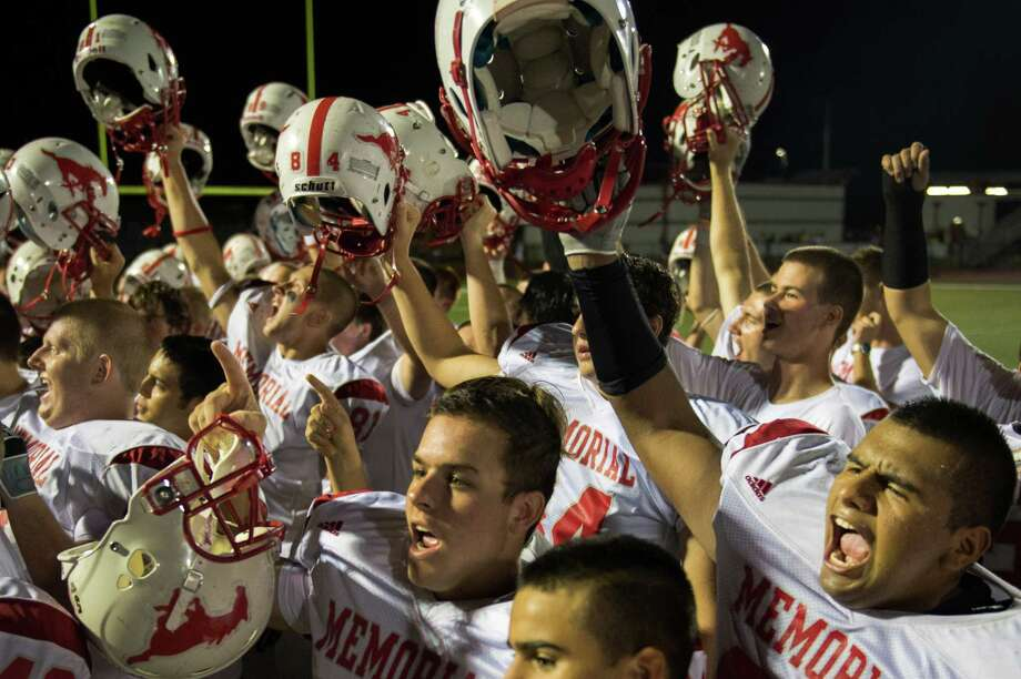Memorial players celebrate their 20-8 victory over Pearland after a high school football game at The Rig on Friday, Sept. 14, 2012, in Pearland. Photo: Smiley N. Pool, Houston Chronicle / © 2012  Houston Chronicle