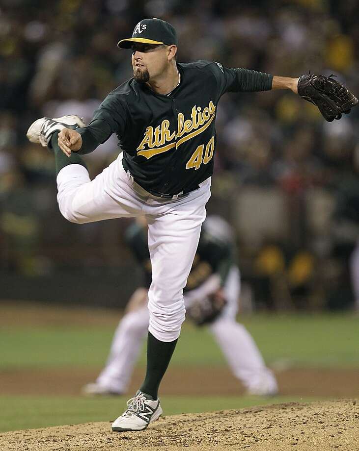Oakland Athletics' Pat Neshek works against the Baltimore Orioles in the seventh inning of a baseball game Friday, Sept. 14, 2012, in Oakland, Calif. (AP Photo/Ben Margot) Photo: Ben Margot, Associated Press