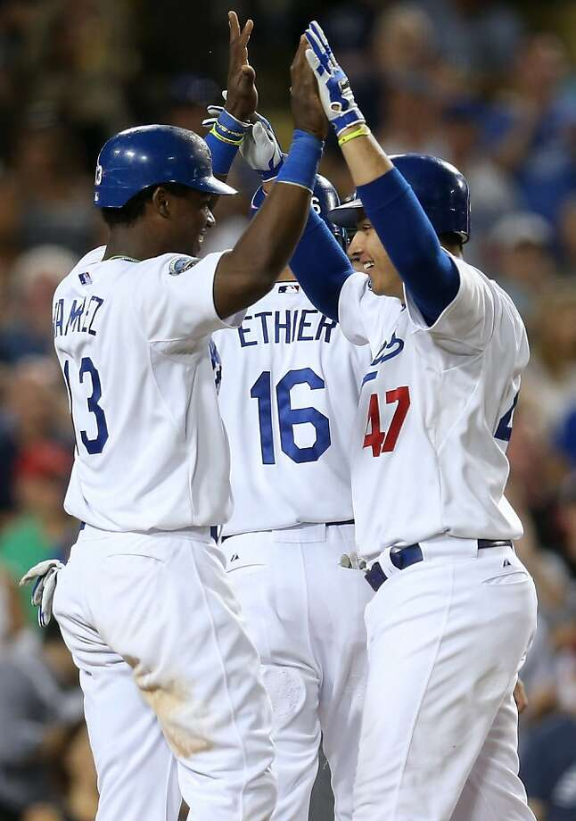 Luis Cruz #47 and Hanley Ramirez #13 of the Los Angeles Dodgers celebrate after both score on Cruz' three run home run in the sixth inning against the St Louis Cardinals. Photo: Stephen Dunn, Getty Images