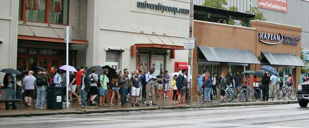 University of Texas students, staff and faculty stand outside after being evacuated from the campus due to a possible bomb threat, Friday, Sept. 14, 2012, in Austin, Texas. The campus was eventually deemed safe and reopened by early afternoon. Photo: Thao Nguyen, Associated Press / FR159307 AP