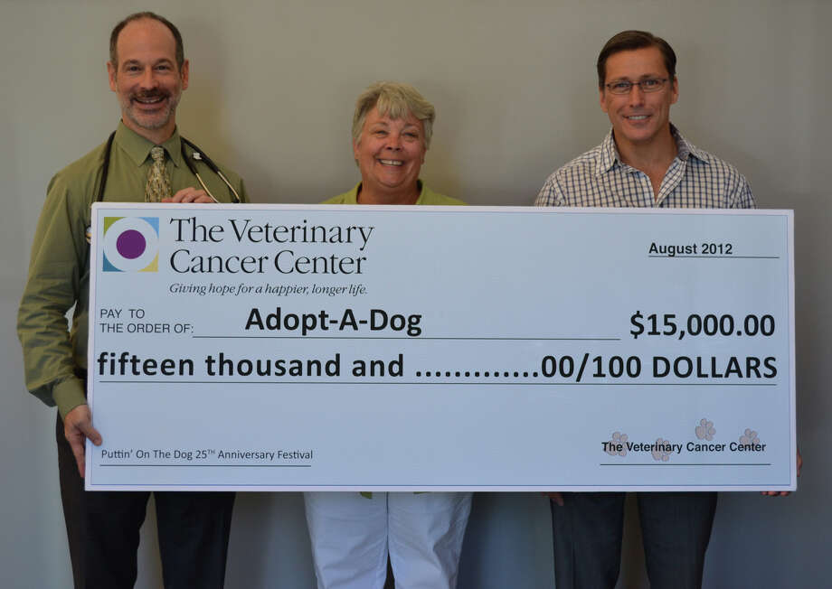 Adopt-A-Dog, a nonprofit shelter and sanctuary for rescued cats and dogs, received a $15,000 donation from The Veterinary Cancer Center that will be used to support the shelterís animal care and adoption initiatives. Above, Dr. Gerald Post, lead oncologist, The VCC; Allyson Halm, president, Adopt-A-Dog; and David Duchemin, chief operating officer, The VCC. Photo: Contributed Photo