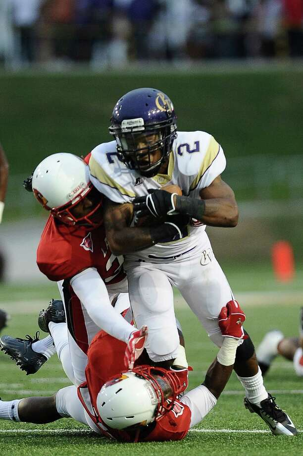 Prairie View running back Fred Anderson is tackled by both Chad Allen and Courtlin Thompson of Lamar at Provost Umphrey Stadium on Saturday, September 8, 2012. Photo taken: Randy Edwards/The Enterprise