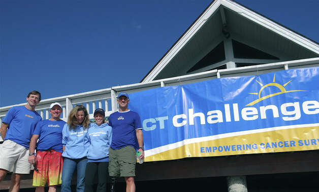 Connecticut Challenge staff at Saturday's paddleboard fundraiser at Penfield Beach, from left: Dave Keith, event organizer; Bob Mazzone, COO; Julia Pemberton, communications director; Tamara Deyle, program director; and Jeff Keith, founder. Photo: Mike Lauterborn / Fairfield Citizen contributed