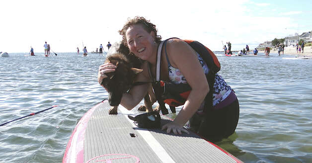Cancer survivor Kari Williams of Fairfield and her dog Lola in Connecticut Challenge's Stand-up Paddle Race at Penfield Beach on Saturday. Photo: Mike Lauterborn / Fairfield Citizen contributed