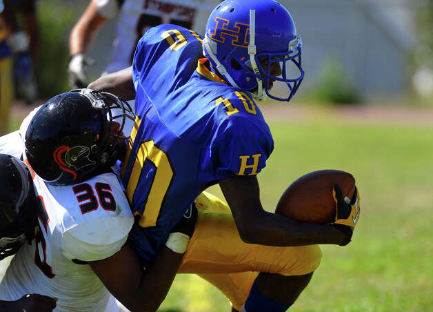 Harding QB Jahaad Williams gets tackled by Stamford's #36 Ryan Lapotts, during boys football action in Bridgeport, Conn. on Saturday September 15, 2012. Photo: Christian Abraham / Connecticut Post