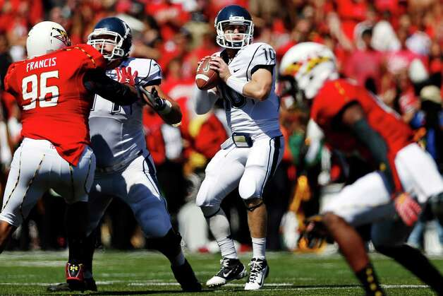 Connecticut quarterback Chandler Whitmer (10) looks for a receiver in the first half of an NCAA college football game against Maryland in College Park, Md., Saturday, Sept. 15, 2012. (AP Photo/Patrick Semansky) Photo: Patrick Semansky, Associated Press / AP
