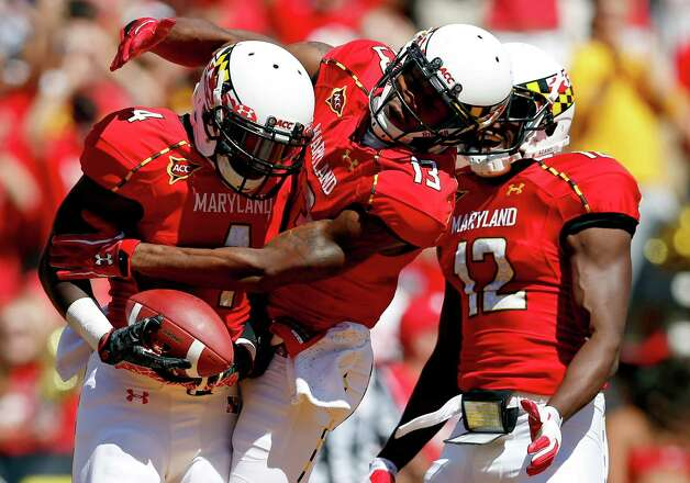 Maryland running back Wes Brown, left, celebrates his touchdown with Kerry Boykins, center, and Kevin Dorsey in the first half of an NCAA college football game against Connecticut in College Park, Md., Saturday, Sept. 15, 2012. (AP Photo/Patrick Semansky) Photo: Patrick Semansky, ASSOCIATED PRESS / Associated Press