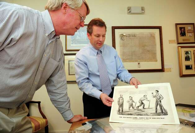 Stephen Rockwell Desloge and Seth Kaller look at a rare Currier & Ives 1860 election print at  Rockwell Art and Framing.  One of seven galleries in Connecticut owned by Stephen Rockwell Desloge, the Westport gallery, Rockwell Art and Framing, recently started specializing in historic documents and other memorabilia.  In the political cartoon, Lincoln, the âÄòRail Splitter,âÄô is depicted as a victorious baseball player, with candidates Bell, Douglas and Breckinridge looking on. This not only is the first identified reference of baseball as the âÄúnational game,âÄù but also can be considered the start of the tradition of sports metaphors in American politics. Photo: Autumn Driscoll / Connecticut Post