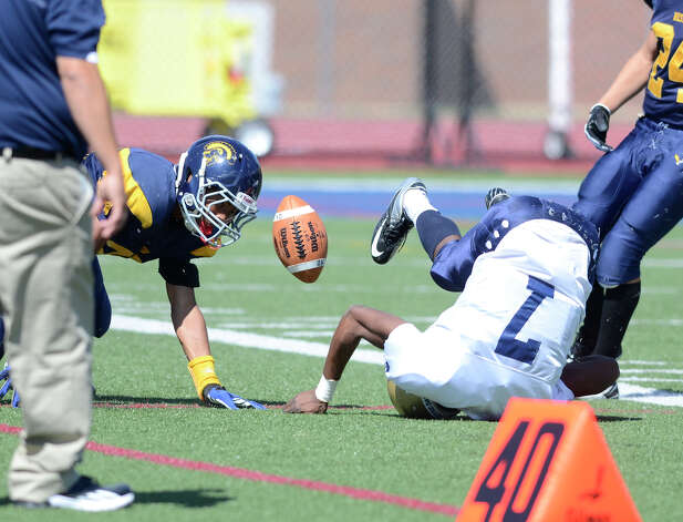 Notre Dame's #7 Glody Tumba tumbles as Weston High School hosts Notre Dame of Fairfield High School in varsity football in Weston, CT on Sept. 15, 2012. Photo: Shelley Cryan / Shelley Cryan freelance; CT Post freelance