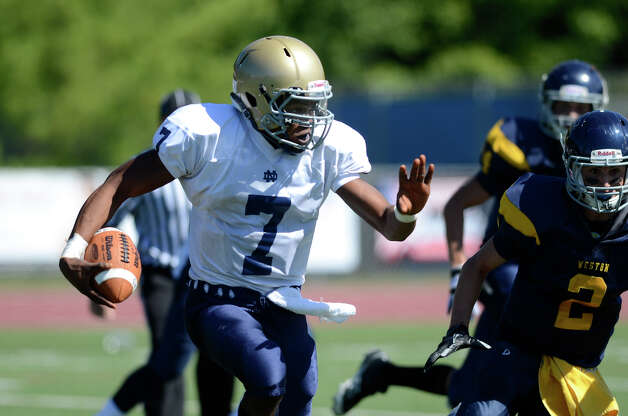 Notre Dame's Glody Tumba gains some yardage as Weston High School hosts Notre Dame of Fairfield High School in varsity football in Weston, CT on Sept. 15, 2012. Photo: Shelley Cryan / Shelley Cryan freelance; CT Post freelance