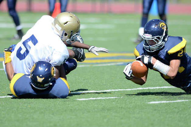 Weston's Justin Schaffer tries to recover a Notre Dame fumble as Weston High School hosts Notre Dame of Fairfield High School in varsity football in Weston, CT on Sept. 15, 2012. Photo: Shelley Cryan / Shelley Cryan freelance; CT Post freelance