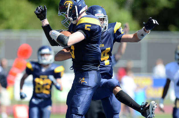 Weston's Erik Dammen-Brower celebrates after scoring a first-half touchdown as Weston High School hosts Notre Dame of Fairfield High School in varsity football in Weston, CT on Sept. 15, 2012. Photo: Shelley Cryan / Shelley Cryan freelance; CT Post freelance