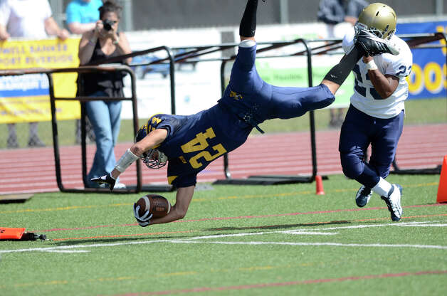 Weston's Justin Schaffer gets airborne as Weston High School hosts Notre Dame of Fairfield High School in varsity football in Weston, CT on Sept. 15, 2012. Photo: Shelley Cryan / Shelley Cryan freelance; CT Post freelance
