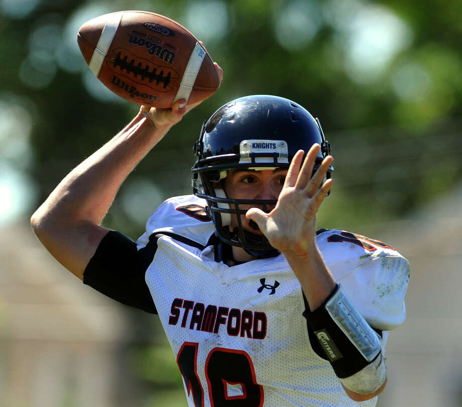 Stamford QB Tyler Kane prepares to pass the ball, during boys football action against Harding in Bridgeport, Conn. on Saturday September 15, 2012. Photo: Christian Abraham / Connecticut Post