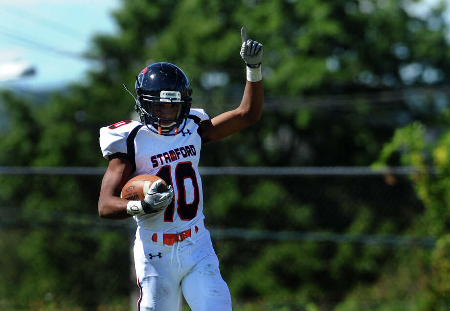 Stamford's #10 John Pasard points his finger in the air after scoring a touchdown, during boys football action against Harding in Bridgeport, Conn. on Saturday September 15, 2012. Photo: Christian Abraham / Connecticut Post