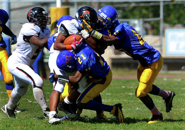 Boys football action between Harding and Stamford in Bridgeport, Conn. on Saturday September 15, 2012. Photo: Christian Abraham / Connecticut Post