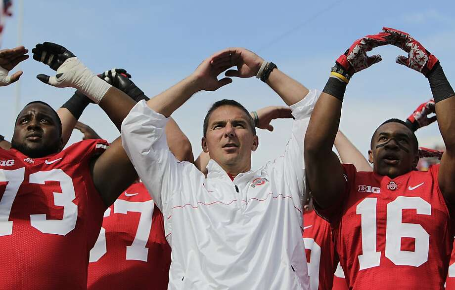 """Ohio State coach Urban Meyer, center, sings """"Carmen Ohio"""" to the band after their 35-28 win over California in an NCAA college football game Saturday, Sept. 15, 2012, in Columbus, Ohio. AP Photo/Jay LaPrete) Photo: Jay LaPrete, Associated Press"""