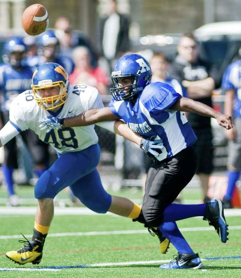 Wilcox Tech High School's Jason Palma and Abbott Tech High School's Jojo Espinal try to prevent each other from catching a pass during a game at Rogers Park. Saturday, Sept. 15, 2012 Photo: Scott Mullin