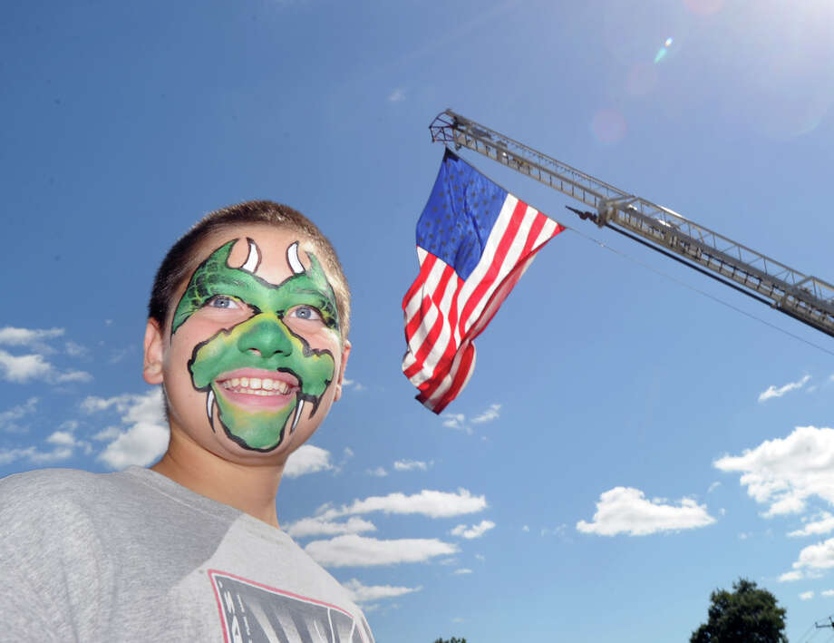 James Bonney, 12, of Greenwich, displays his dragon face that was painted by Greenwich artist Laura Murphy during the seventh annual Party in Pemberwick Park, Saturday afternoon, Sept. 15, 2012. Photo: Bob Luckey / Greenwich Time