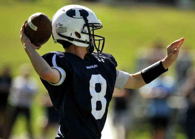 Immaculate quarterback Matthew Ryan readies to throw during their game against Oxford at Immaculate High School in Danbury on Saturday, Sept. 15, 2012. Oxford won, 35-0. Photo: Jason Rearick / The News-Times