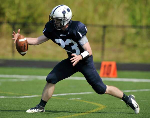 Immaculate's Michael Woods fields a kickoff return during their game against Oxford at Immaculate High School in Danbury on Saturday, Sept. 15, 2012. Oxford won, 35-0. Photo: Jason Rearick / The News-Times