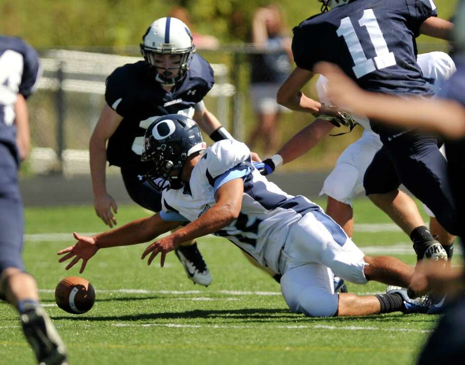 Oxford quarterback Brennen Diaz jumps on the fumbled ball during their game against Immaculate at Immaculate High School in Danbury on Saturday, Sept. 15, 2012. Oxford won, 35-0. Photo: Jason Rearick / The News-Times