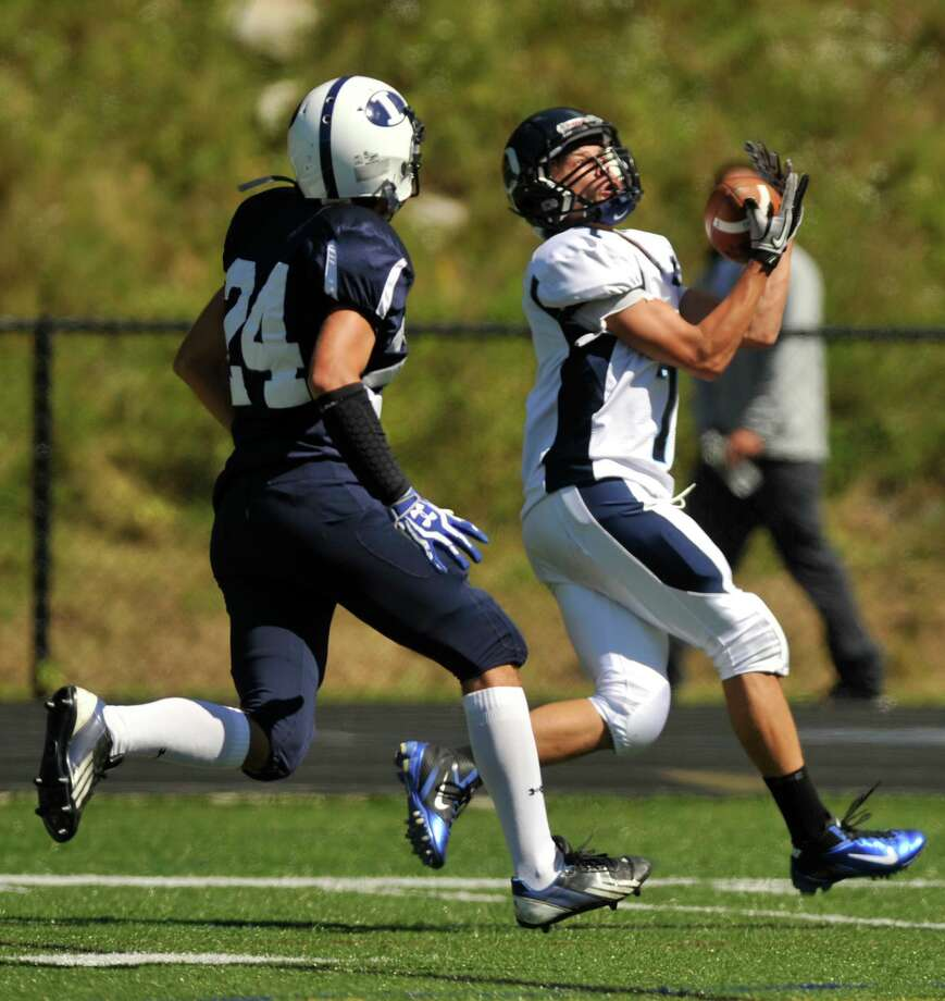 Oxford's Chris Vankamerik catches a ball for a touchdown as Immaculate's Gage Bove chases during their game at Immaculate High School in Danbury on Saturday, Sept. 15, 2012. Oxford won, 35-0. Photo: Jason Rearick / The News-Times