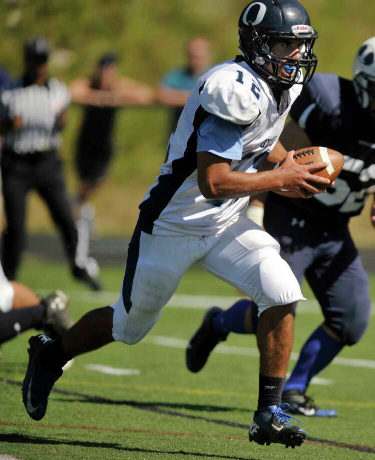 Oxford quarterback Brennen Diaz runs the ball into the end zone during their game against Immaculate at Immaculate High School in Danbury on Saturday, Sept. 15, 2012. Oxford won, 35-0. Photo: Jason Rearick / The News-Times