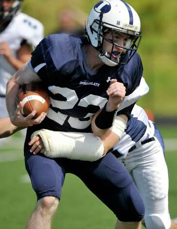 Immaculate's Michael Woods is brought down by Oxford's Gunnar Fay during their game at Immaculate High School in Danbury on Saturday, Sept. 15, 2012. Oxford won, 35-0. Photo: Jason Rearick / The News-Times