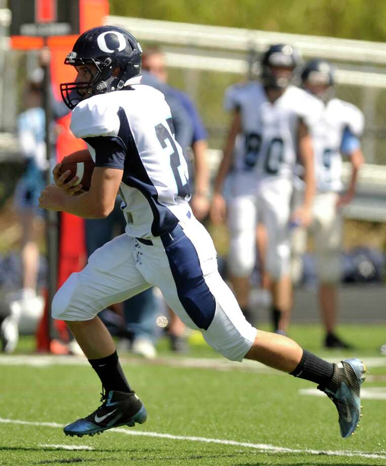 Oxford's Steve Persson runs the ball during their game against Immaculate at Immaculate High School in Danbury on Saturday, Sept. 15, 2012. Oxford won, 35-0. Photo: Jason Rearick / The News-Times